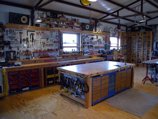 Shop Organization Work Bench In Middle With Storage All Around