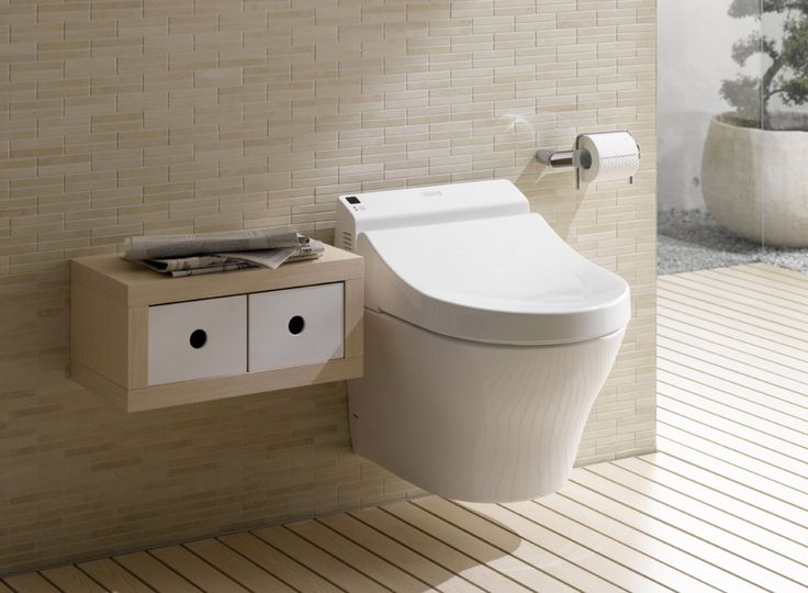 Toto Wall-hung, rimless toilet with washlet seat.  Clean lines = easy to keep clean.  More modern than M's typical style, but in a closet, what does it matter?  But pricey option, need to research other wall-hungs.  Duravit has some negative reviews for their flush style.