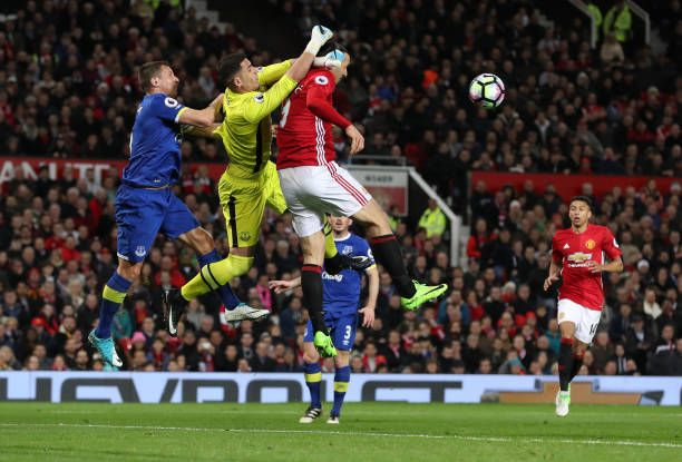 Manchester United's Zlatan Ibrahimovic contests a header with Everton goalkeeper Joel Robles during the Premier League match at Old Trafford...