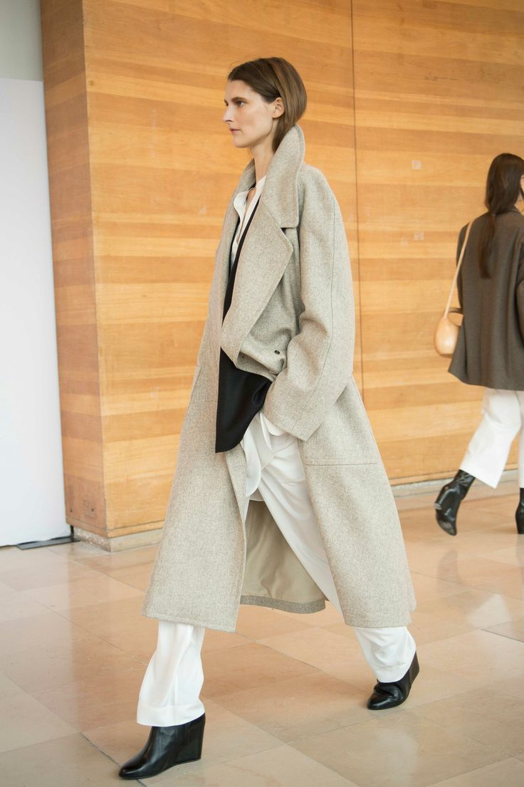 18. Coat in felted virgin wool / Long jacket in virgin wool and cashmere / Liquette dress and elasticated pants in washed silk / Boots in calf leather