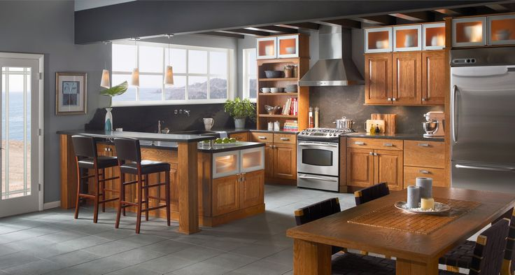 A kitchen of oak and warm toffee is enhanced by aluminum for Add glass to kitchen cabinets