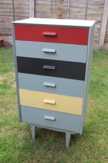 This stunning Retro Tallboy has been hand painted in 'Duck Egg' chalk paint by Annie Sloan. With Red, Black and yellow drawers.With its multicoloured drawers, it has a funky yet vintage look about it. These drawers will instantly attract attention.  A funky and vintage piece for your home.   ______________________________________________________ PLEASE CONTACT US IF YOU WOULD LIKE A QUOTE FOR DELIVERY***  ___________________________  Dimensions: W: 61cm; D: 41cm; H: 106cm