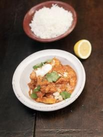 chicken tikka masala with fluffy rice and flaked almonds