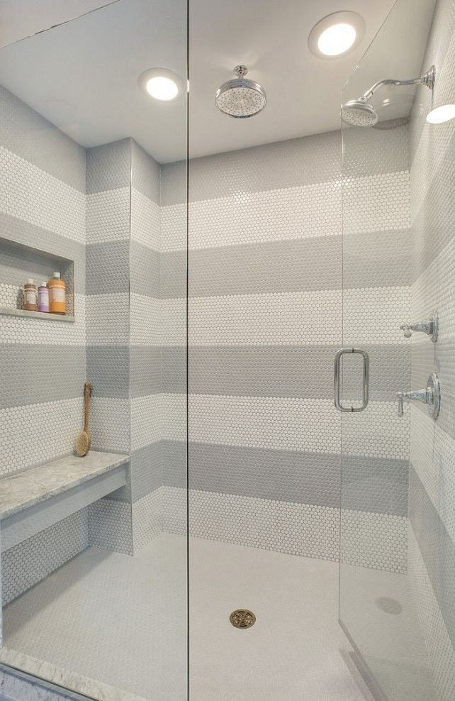 Having a #pattern in your #bathroom may not be everyone's cup of tea, but this #shower showcases how beautiful it can be to have a contrast. www.remodelworks.com