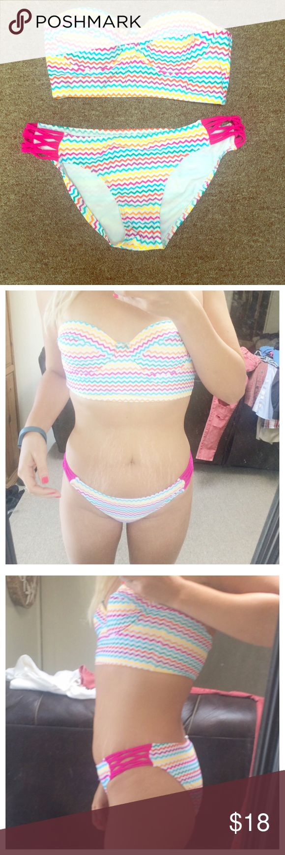 Tube top bikini White Bikini with colorful stripes. Never looked right on me since I'm small chested. I also don't like showing off my stretch marks. Good condition. Swim Bikinis