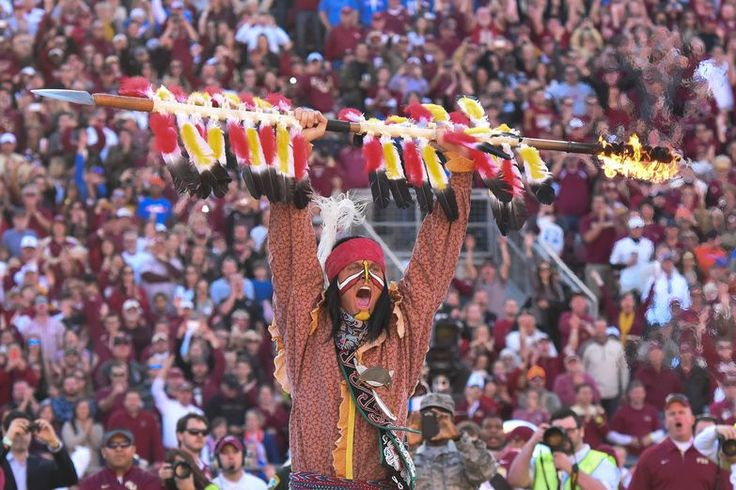 Seminole Warrior Osceola dismounts only prior to FSU vs. UF football games; exciting crowd and then planting his spear at midfield.