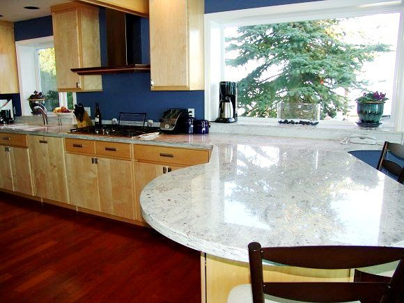 Im Trying To See What White Granite Counters With Hickory Cabinets And Dark Floors CountertopsHickory CabinetsBlue WallsKitchen