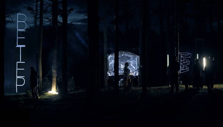 Noosphere is an installation created by a projection net in the space between the trees at a height of 8 meters. Holographic letters were falling down on the audience like drops of rain. With a help of an optic sensor letters could feel the presence of the spectator an interact with his silhouette. Artist: Inty ++ Year: 2015