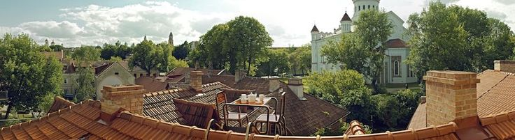 Ridge Roof furniture by Ainė Bunikytė transforms Vilnius pitched roofs in panoramic design set for a romantic cup of tea.  http://www.archipanic.com/ridge-roof-design/  Photo by Kernius Pauliukonis, courtesy of Ainė Bunikytė