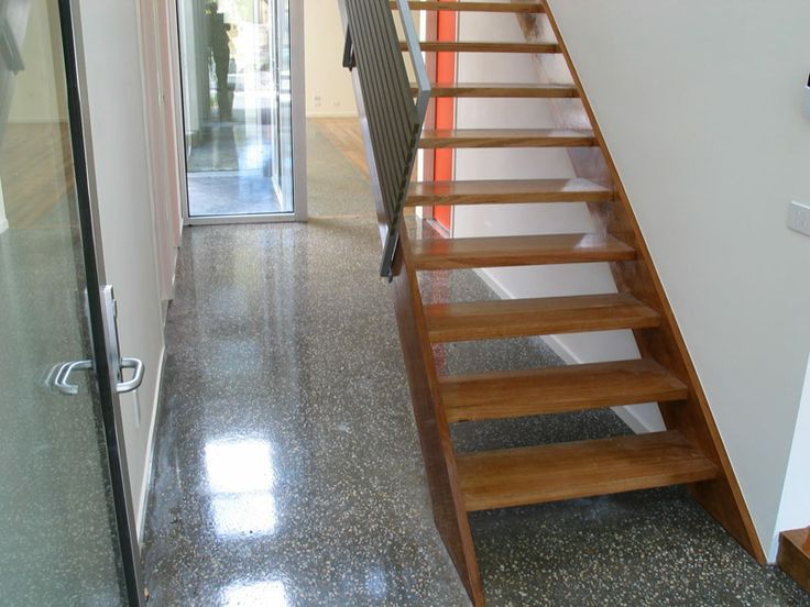 Vic Ash 42mm thick treads and stringers with custom steel and painted timber balustrade. Stain finish to stairs.