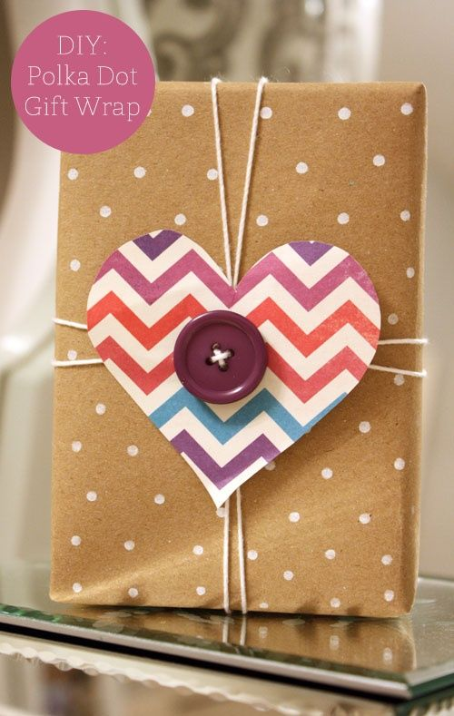 We spotted our chevron scrapbook paper   tied up in this adorable DIY polka dot gift wrap! via For Chic Sake