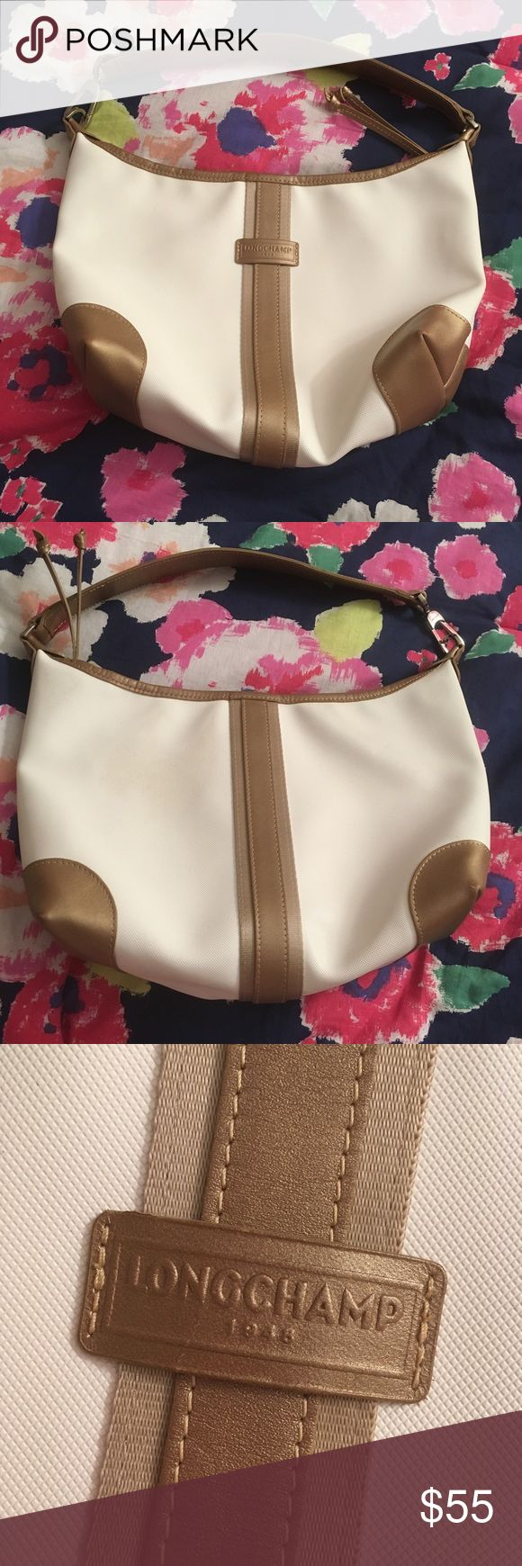 Vintage Longchamp White/Cream & Gold Shoulder Bag Pre-owned vintage longchamp in beige and gold/bronze. Some yellow spots in the interior and some on the back of the bag. Wear on the corners and leather are shown. Made in France. Leather. 8 inches x 10 inches Longchamp Bags Shoulder Bags