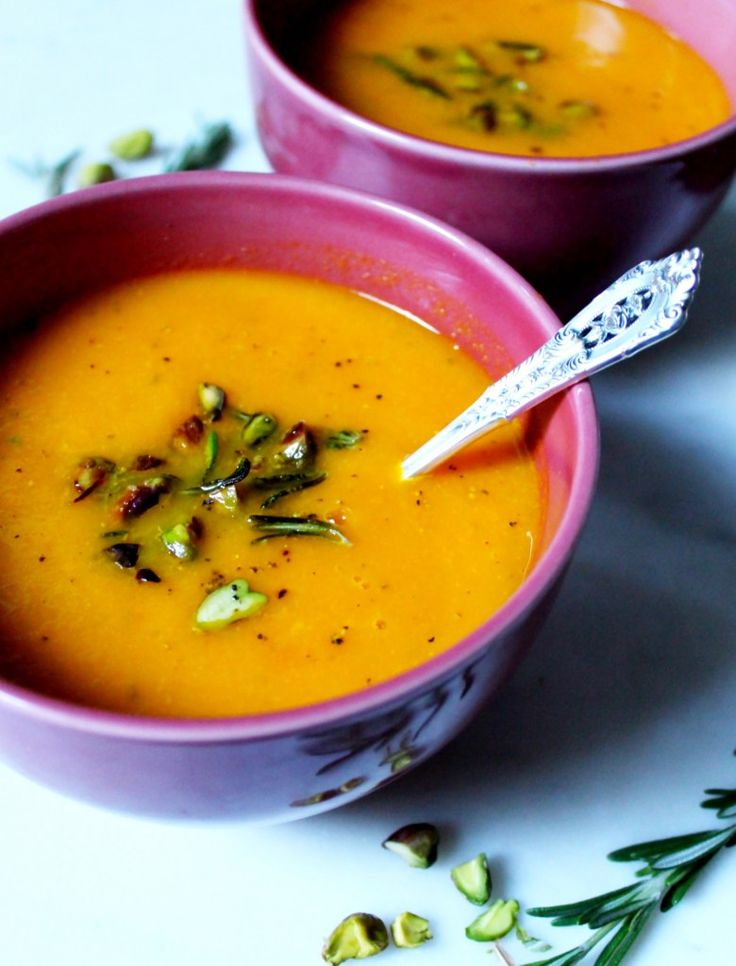 Carrot, Apple & Rosemary Soup. Gluten free, dairy free, vegan and paleo. Recipe on www.thelittlegreenspoon.com