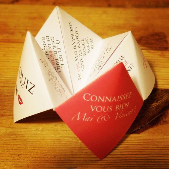 Quiz sur les mariés à l'aide d'une cocotte en papier, posée directement sur la table des invités ©LFP