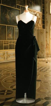 Designed by Bellville Sassoon-Lorcan Mullany.  Black with shoulder straps embroidered with gold sequins, gold bugle bead and paste. Diana first wore wore this gown in October 1987. She wore it again in Canada, 1991,  and to attended a gala of the Kirov Ballet at the London Coliseum in July 1993.  $23,000.00 Purchased by Don and Deborah Brown, California