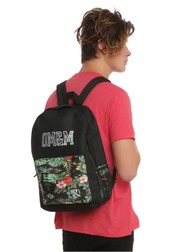 Backpack with an OM&M tropical floral design, padded shoulder straps, fully padded back panel and web haul loop.