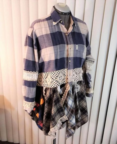 Upcycled Recycled Altered Couture Fashion Remix Plaid Flannel Shirt Refashion Size Large 2X Embellished clothing TPPS5-04 This offering is blue and grey plaid flannel shirt refashioned into an artsy tunic. The flannel shirt was cropped and reworked with squares of reclaimed flannel