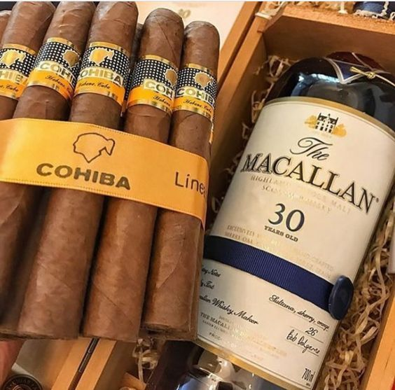 "Cohina Robusto cigars from Havana, and The Macallan 30-year-old single malt Scotch whisky. These Cubans benefit from at least a few yeas of aging. Pre-light aroma is woodsy and earthy, with the foot yielding hints of leather and cedar. Pre-light draw is easy and provides cedar and earthy tones. The first few draws greet you with a very peppery blast with hints of cedar and leather, and great white clouds of ""creamy"" smoke. More of this review at…"