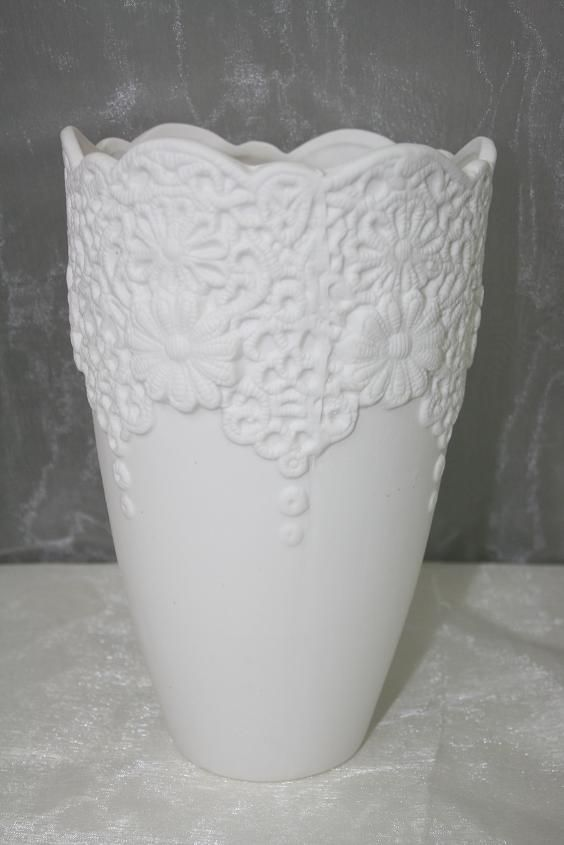 BBVWV This elegant white matte porcelain vase will give a lovely touch to a baby blue and white theme