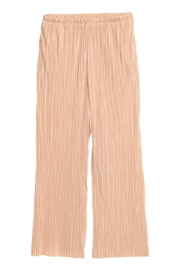 Pleated trousers: Ankle-length pleated trousers in glossy jersey with an…