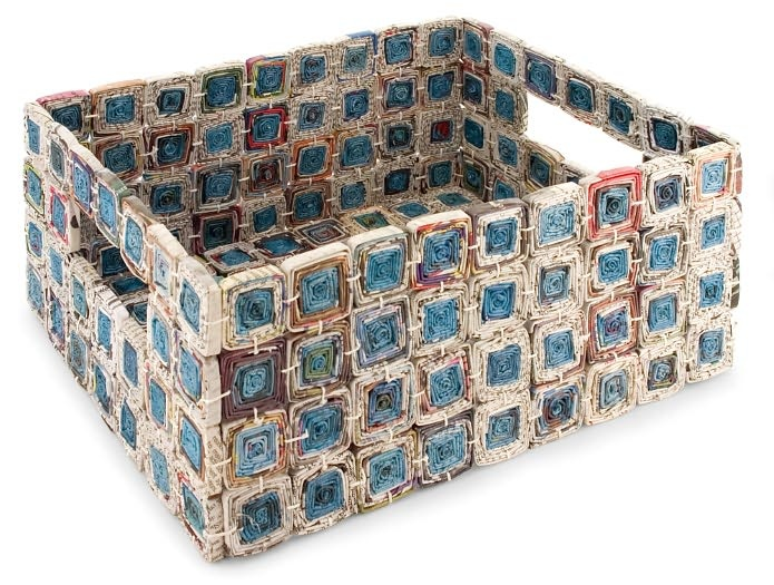 Saw this at B But as a tote with handles. Rolled newspaper made into squares and fastened together with twine or something similar. Definately do able!