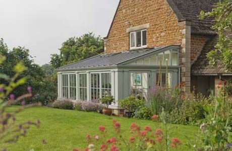 Traditional lean-to conservatory featuring single and double columns.