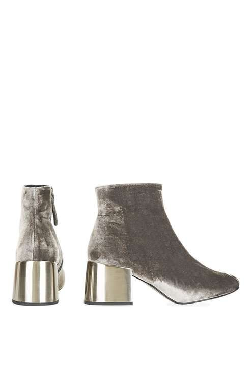 Make a statement with your ankle boots this season in this cool grey velvet pair featuring an eye-catching metal mid-heel, seriously stylish and perfect for daily wear. #Topshop