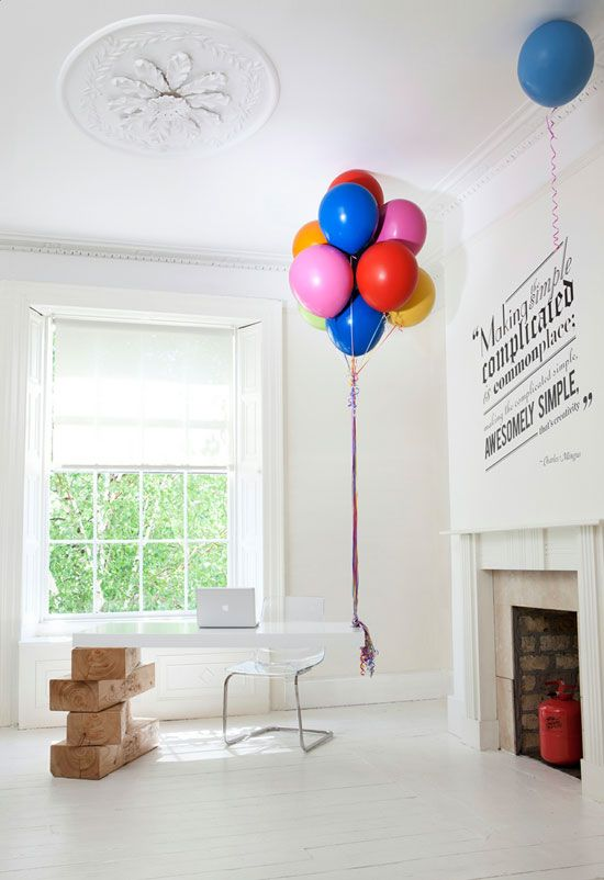 Crazy cool gravity-defying desk carefully balanced with giant Jenga blocks and real helium balloons.
