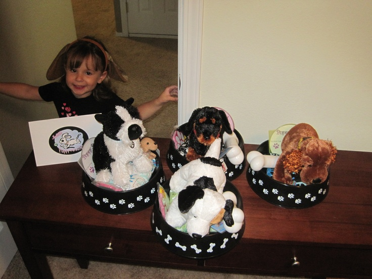 Puppy party: Each girl got to adopt a new puppy! Pet beds are dog bowls from the dollar store with homemade cushion.
