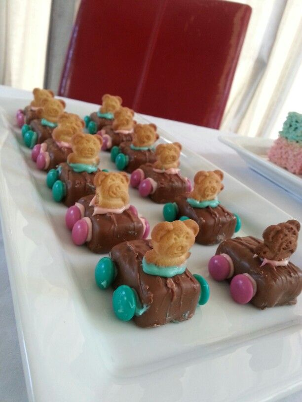 Gender reveal party - pink and blue cars.