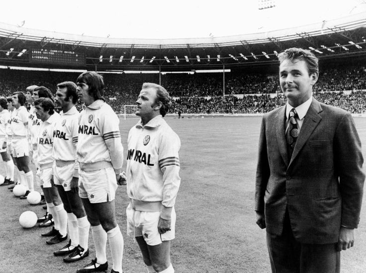 The space between says it all as Brian Clough lines up with his players during his ill-fated 44-day stint as Leeds manager, 1974
