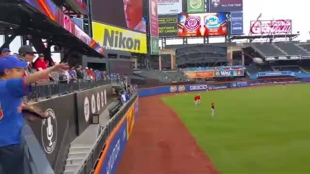 Before Wednesday's game in New York, Washington Nationals pitcher Max Scherzer tossed the ball with a young Mets fan who was watching from the outfield stands.