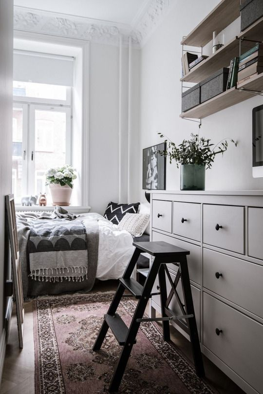 Small bedroom decor with storage space