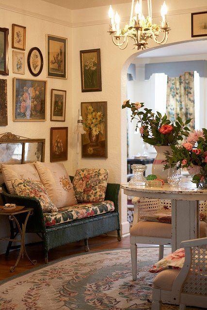 Vintage charm, wicker seating, vintage pictures via: Boho Furnishings