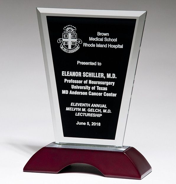 "This Black Glass Award on Rosewood (G290678) features a black glass with a beveled edge mounted on a high gloss rosewood base. The black area will be laser engraved for personalizations. This award comes in three different heights. They are G2906 8"" tall, G2907 9"" tall, and G2908 10"" tall. All three measure 6"" wide and 2.25"" in length."