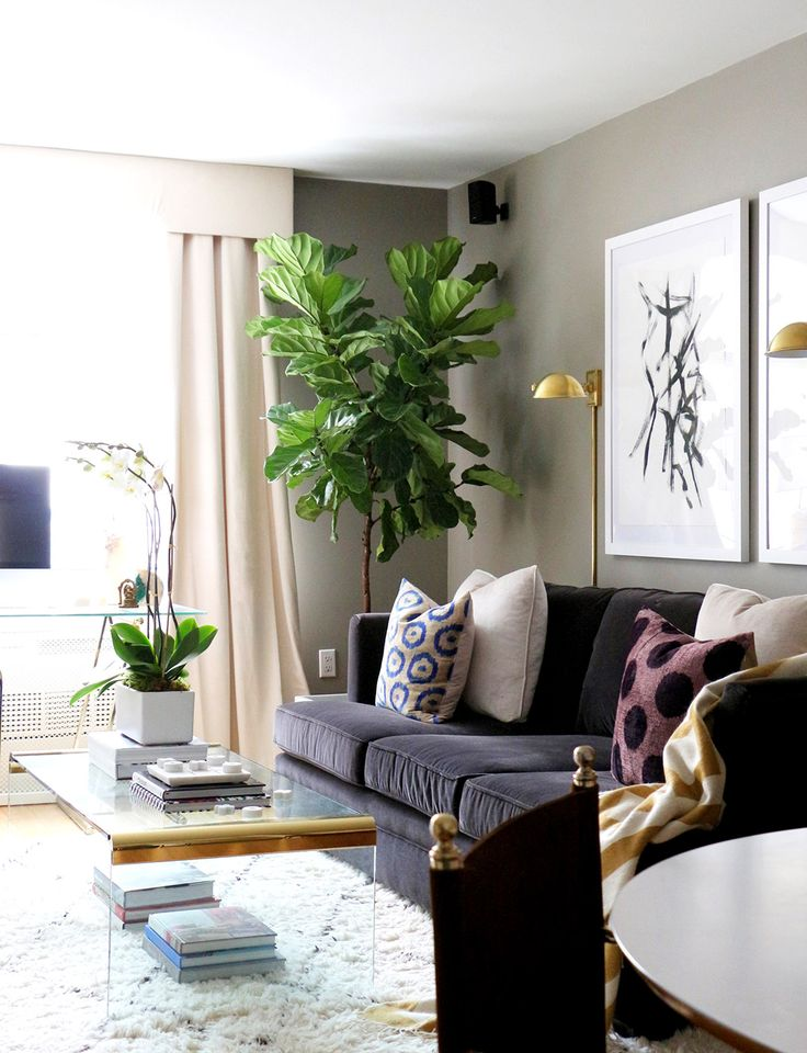 Black And White Oversized Artwork In Living Room With Sofa Gold Wall Sconce