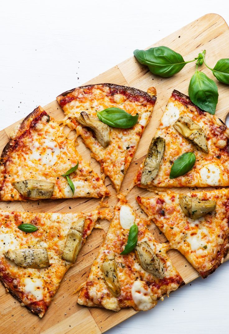 A picture says more than a thousand words. Who can resist this creation? A vegetarian pizza filled with cheese and wonderful flavors on a delicious crust.