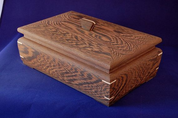 """This box is handmade from Wenge, an African hardwood. I think the wood is beautiful but when a finish is applied the stunning grain pattern is lost. So I chose to leave it unfinished. The box measures 7 1/2"""" by 11 1/2"""" by 5"""". $252.44"""