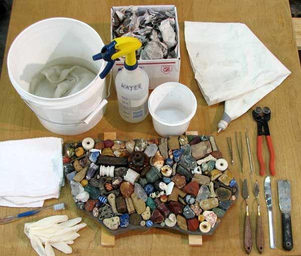 thinset workstation for detailed mosaic artwork, detailed information on using thinset to set your tiles. If you want a piece to be waterproof such as in a birdbath, you have to use thinset.  Easy to mix and it doesn't require much more than water and the mix.
