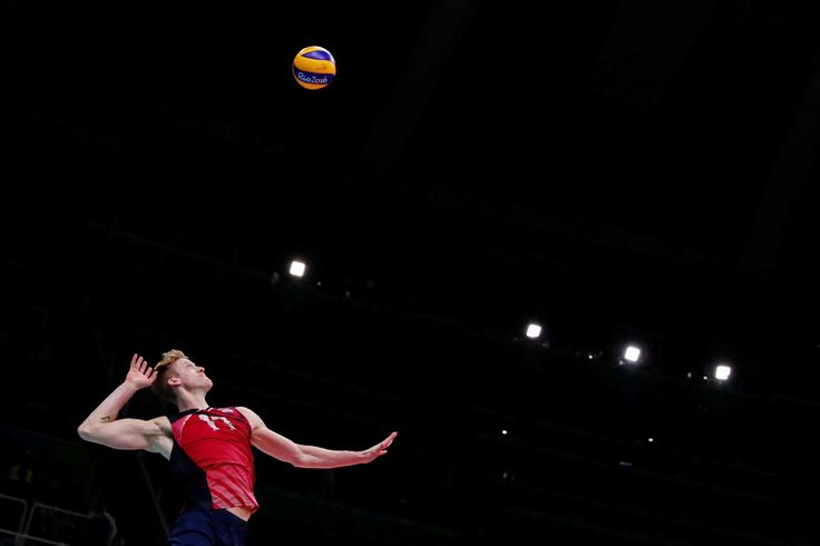 High toss: Maxwell Holt of United States serves during the men's bronze medal match between United States and Russia on Aug. 21. The U.S. won the match.