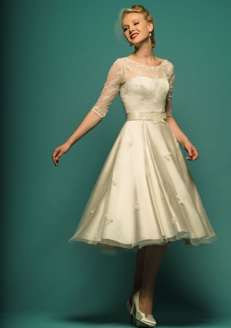 Lou Lou- Brigitte, beautiful Tea Length, lace bridal gown, with lace sleeves. Available at The Tailor's Cat, Cambridge 01223 366700