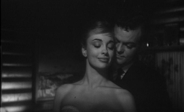 som Chefens kone, i Alarm i Østersøen eller Sorte Shara fra 1961.(her sammen med Ebbe Langberg)