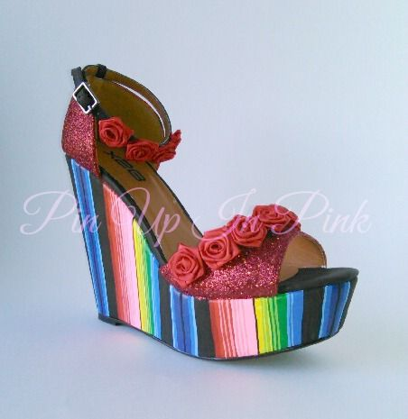Custom one of a kind pair. 100 percent handmade. Serape painted shoes with red glitter and handmade ribbon roses. #serape #heels #shoes #wedges #Mexican #chola #pinup #rockabilly #diadelosmuertos #dayofthedead #red #glitter #roses #latina #ribbon #original #pinupinpink #platforms #custom #cincodemayo
