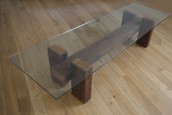 ITEM PRICE DOESNT INCLUDE SHIPPING COST.  please contact us with your location and we will provide you with a shipping quote for your destination.  This unique coffee table is created from the century-old 100% reclaimed wood. Innovative combination of rustic texture and simple clean lines of glass makes this table really original, creates link between centuries, old and modern at the same time. Glass top is 10 mm thick. Its transparency reveals timeless beauty of wood. The unique property…