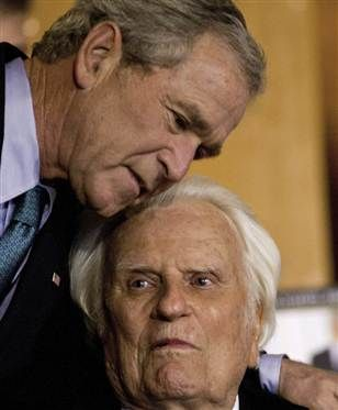 "Former President George W. Bush shares a hug with Billy Graham while signing copies of his new book ""Decision Points"" at the Billy Graham Library in Charlotte, N.C., last Dec. 20, 2010."