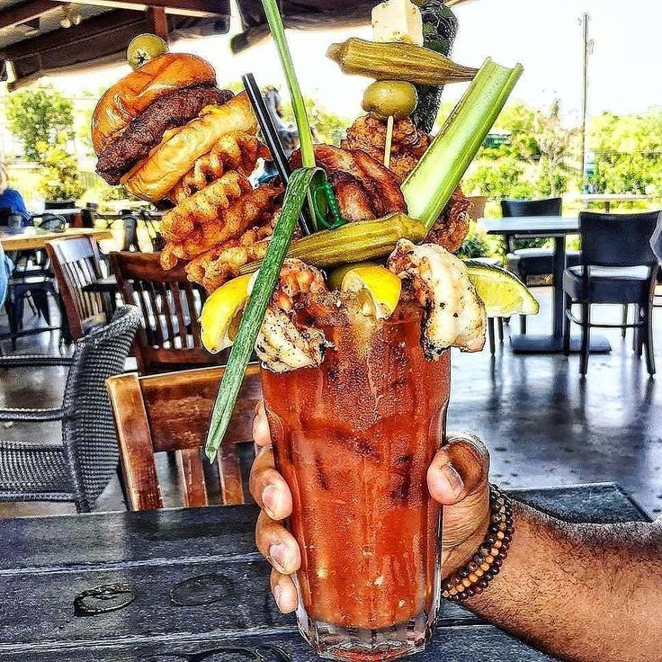 Seriously tho??! Where to even start??Ultimate Surf and turf bloody mary! Loaded with stacks of burgers waffle fries and perfectly grilled prawns. Not to mention the homemade tomato juice peppers a garden of fresh greens & an extra shot of peppery vodka! #myfoodeatsyourfood  . Courtesy: @flybyeats at @chefpointcafe | @regrann via @thrillist @boozeclues  #bloodymary #grill #grilling #bbq #barbecue #texas #food #foodporn #breakfast #brunch #meat #meatlover #paleo #burgers #fries #drink #steak…