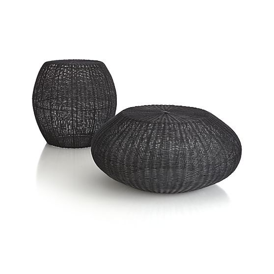 Aracari Low Table Collection | Crate and Barrel - Tall $199 (18.75 dia x 18.25H) -- Low $199 Clearance (26.25 dia x 12.15H) - Bird's nest of woven wire opens up to a host of living space options. Dark metallic wire takes flight in an open airy mesh as a casual table or extra seat. Upended, it opens to become a great-looking container for a lush stand of bamboo or a modern umbrella stand.