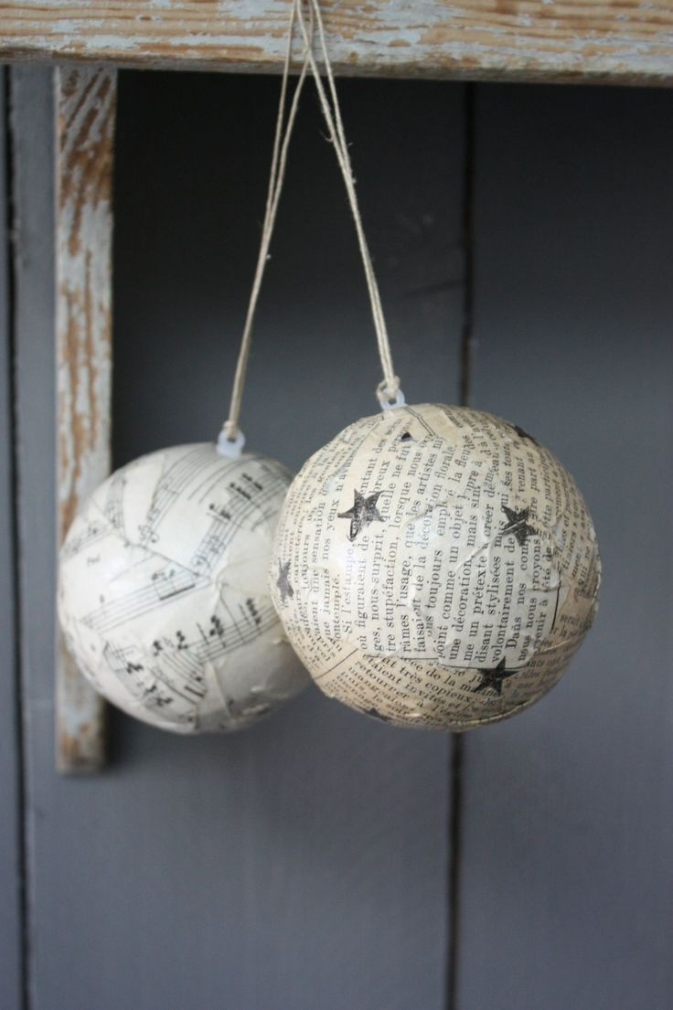 DIY Christmas ornaments - like the idea of using old music sheets and mod podge to styrofoam balls
