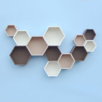On trend pastel blues with taupe & grey honeycomb shelving.