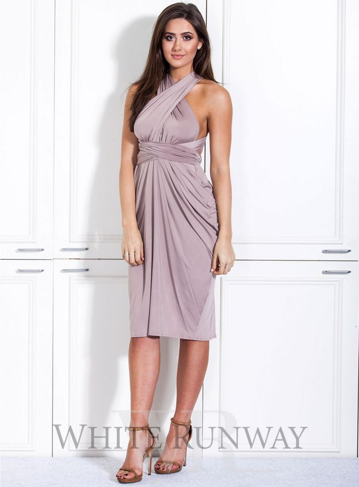 Nicolangela Goddess Cocktail Dress. **Dresses are custom made to order so no returns are accepted on this style. Please contact us if you would like to arrange a sample order.**   A beautifully draped multi-way dress by Nicolangela. Made of a beautiful poly, spandex blend knit that can be styled over 8 different ways.